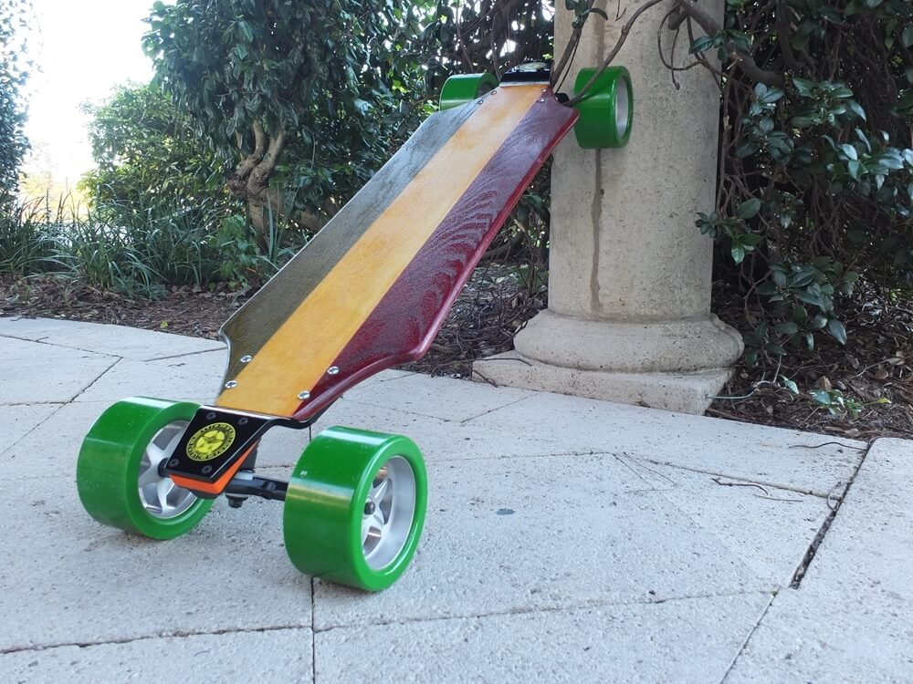 Rasta Wood DonkBoard w/ Aluminum Landpaddle Pole. Yellow Heart Oak Wood: Stained Green and Red